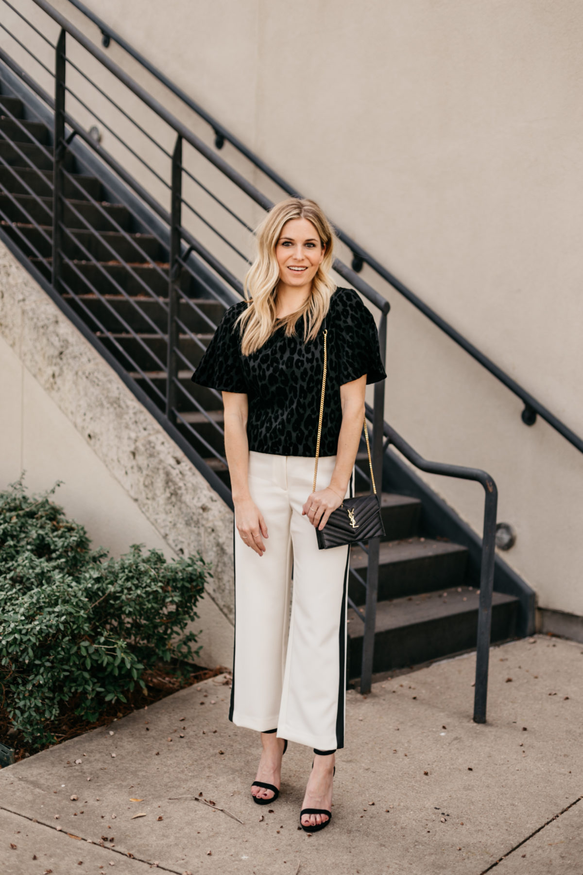OUTFIT 3  White Wide Leg Stripe Pants // Black Short Sleeve Blouse // Black and Gold Crossbody Clutch // Black Strappy Heels