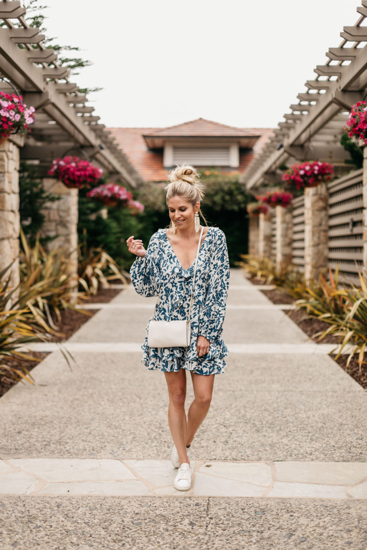 Brooke's outfit: Blue Long Sleeve Ruffle Minidress // White Earrings // White Crossbody // White Walking Tennis Shoes