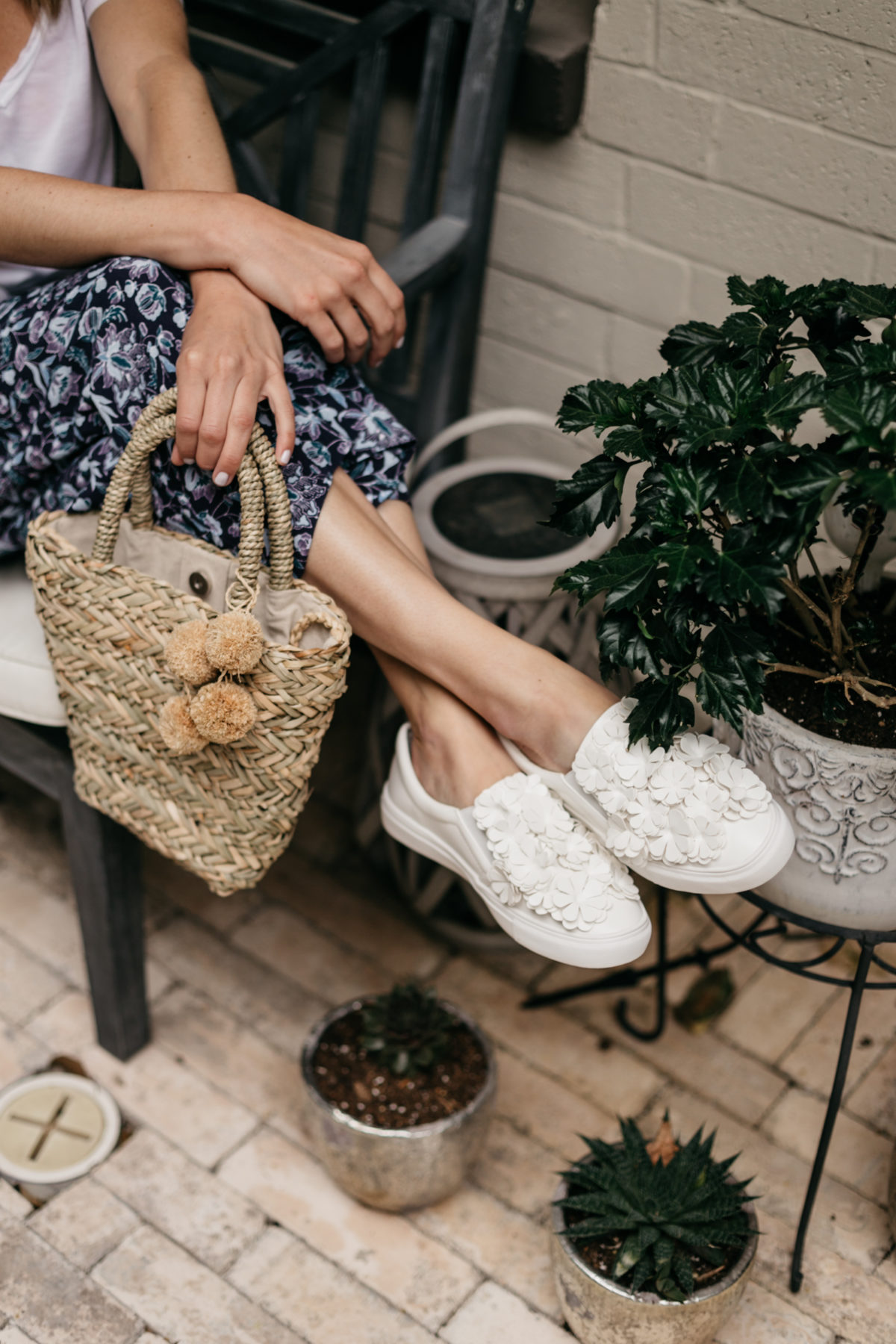White sneakers and woven bag