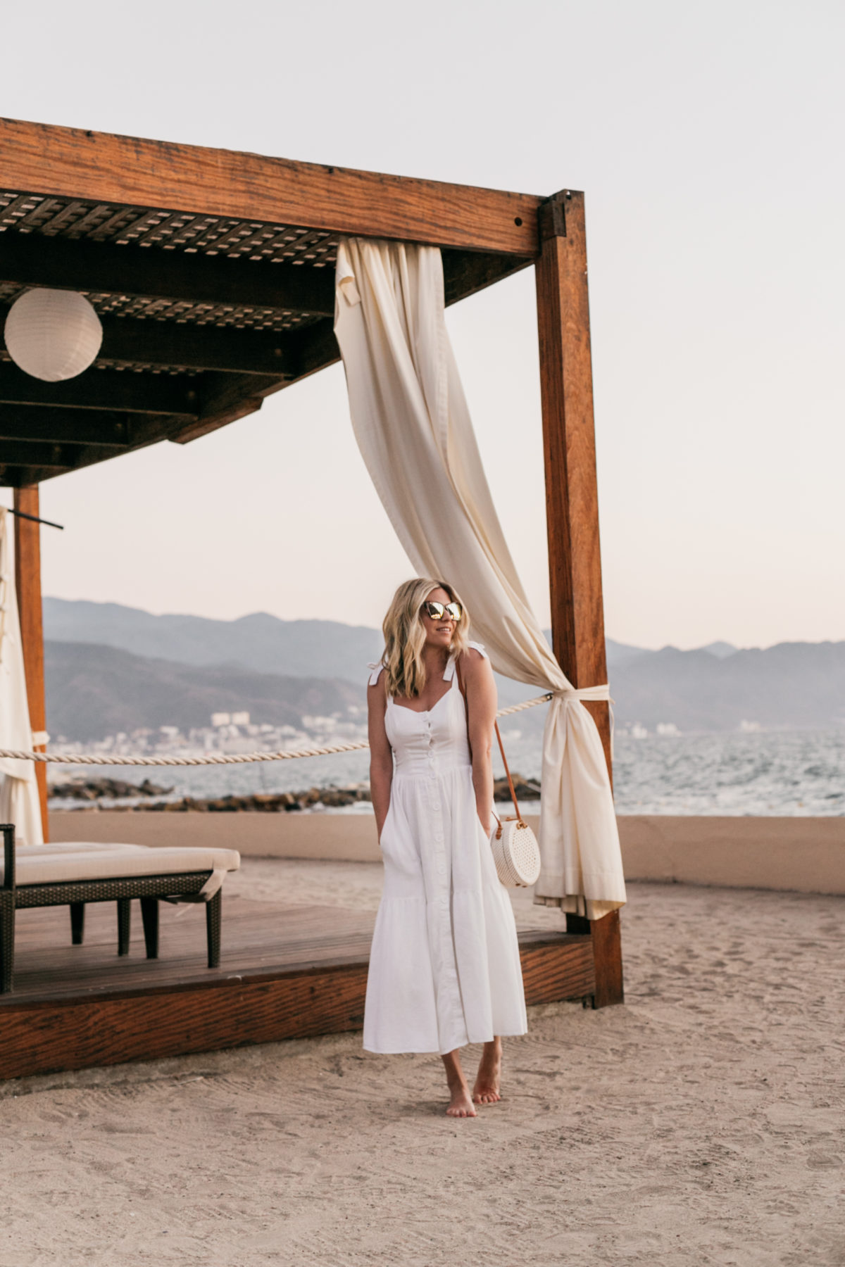 One Small Blonde is featuring a White Midi Dress // Circle Rattan Bag // Sunglasses