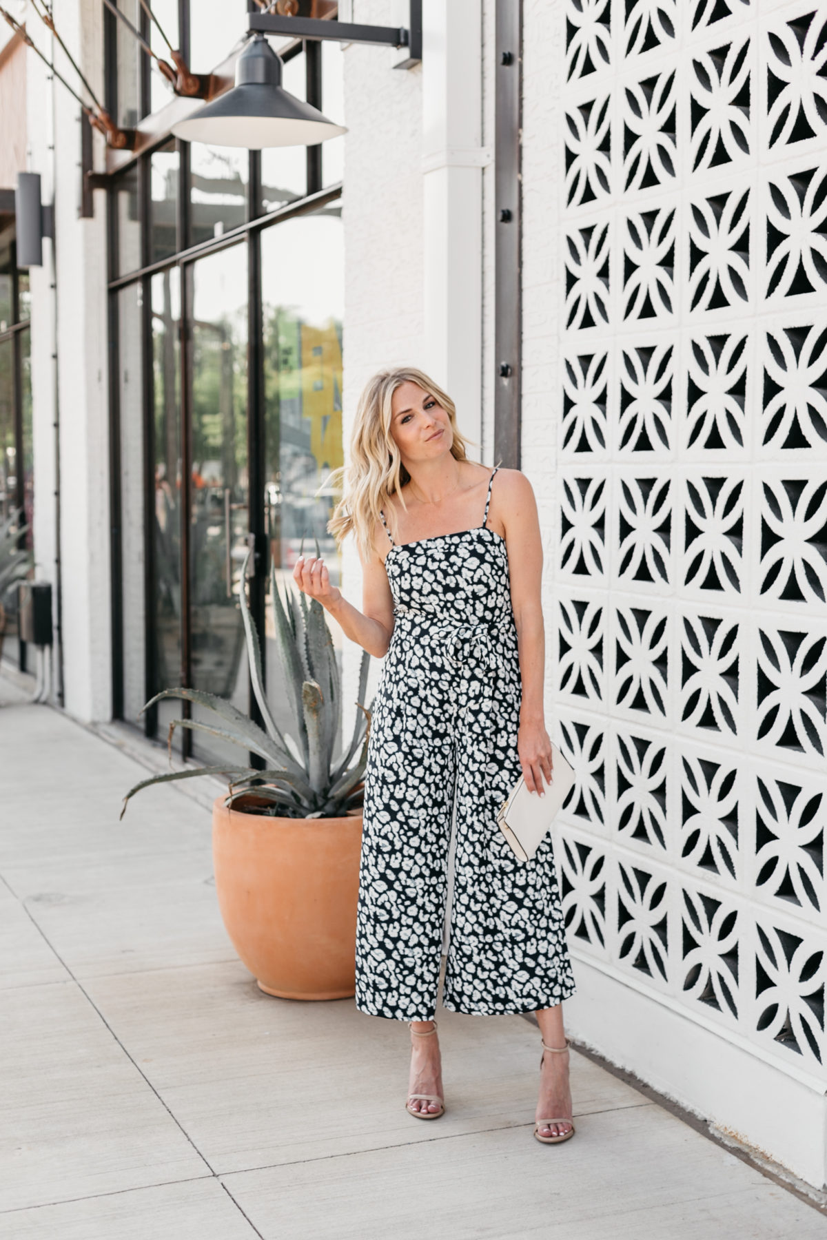 One Small Blonde is wearing a jumpsuit from Banana Republic