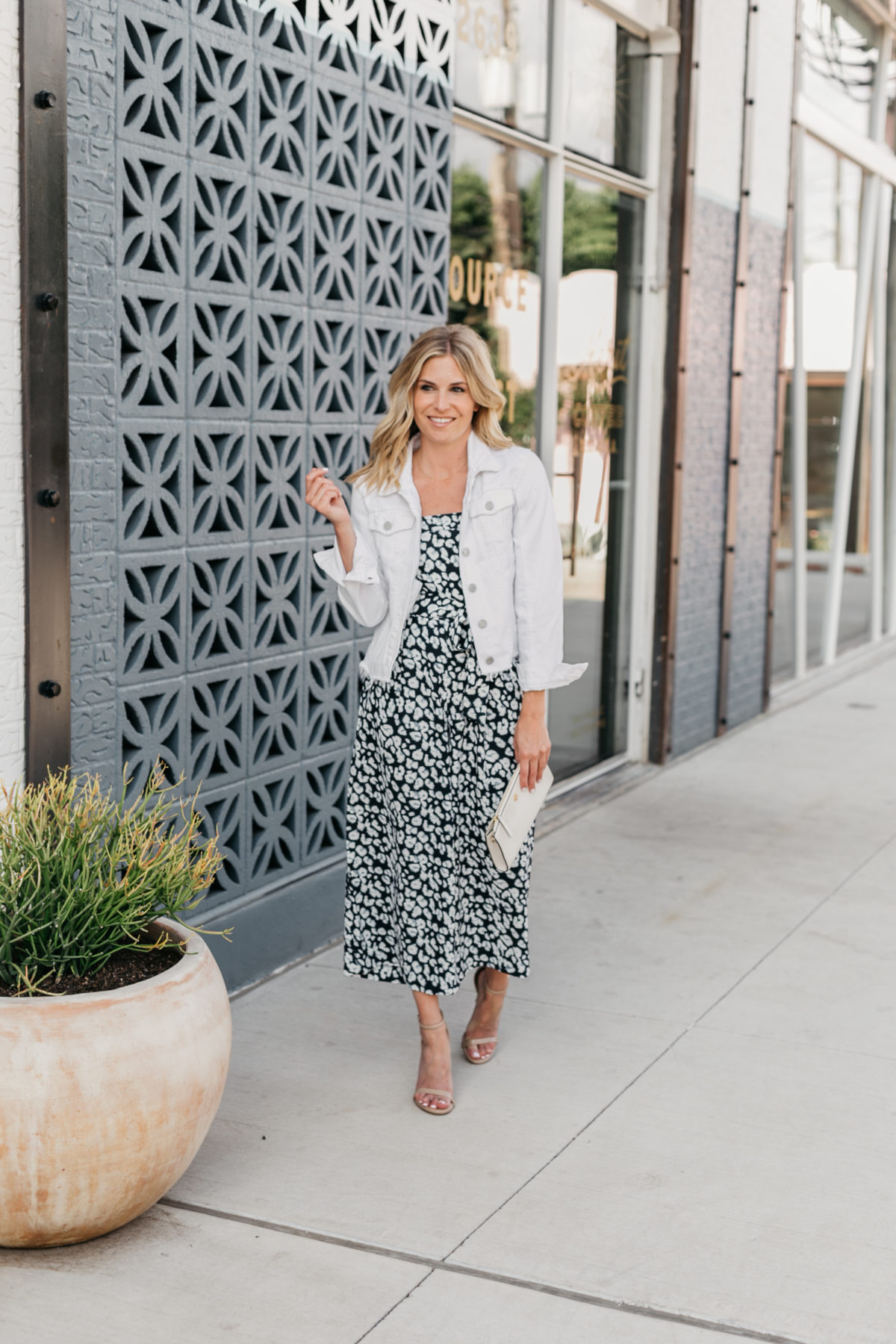 summer vacation outfits - White jacket and navy leopard jumpsuit from Banana Republic