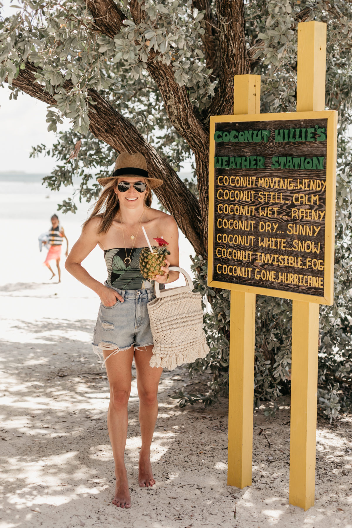 ROYAL CARIBBEAN CRUISE & A Cruise Outfit: Palm Print One Piece Swimsuit // Distressed Denim Shorts // Macrame Beach Bag // Gold Crescent / Coin Necklace // Straw Hat // Aviator Sunnies
