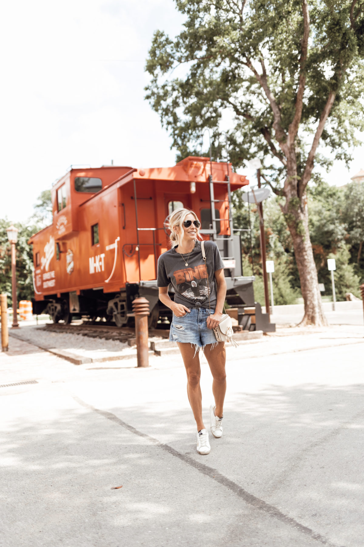 woman wearing denim shorts and shirt MEMORIAL DAY WEEKEND OUTFITS
