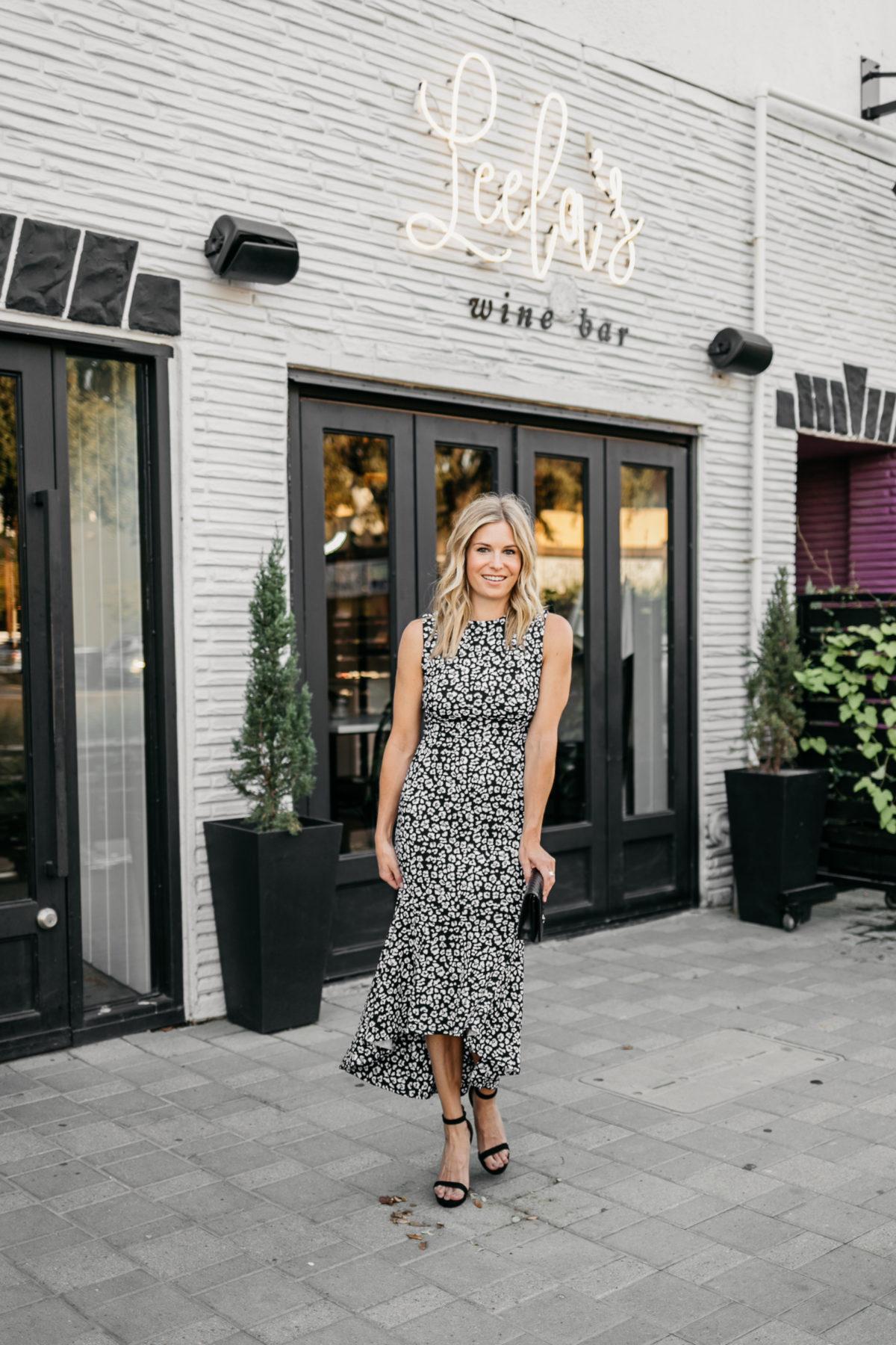 a woman in a leopard dress