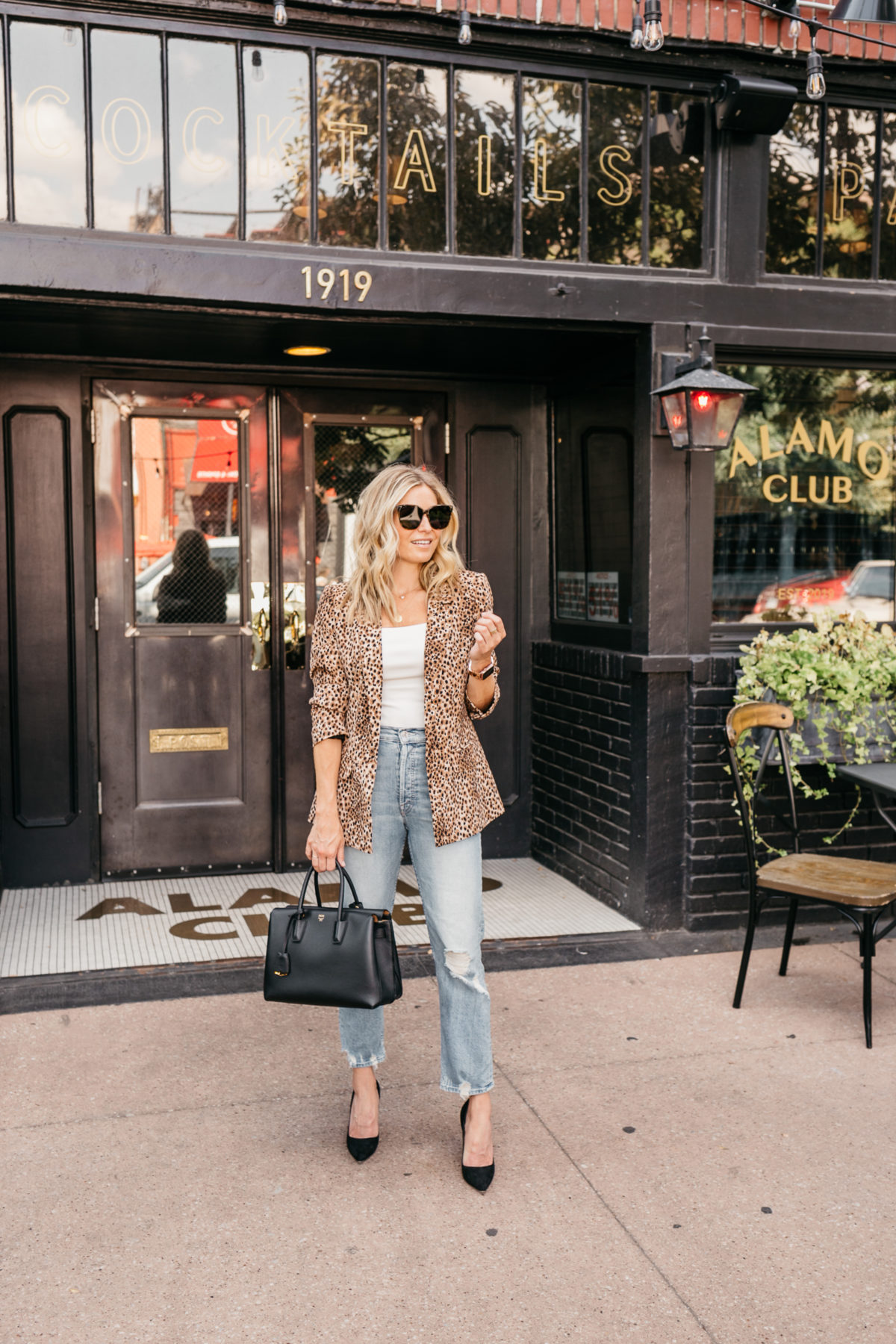a girl who is teaching us how to wear leopard