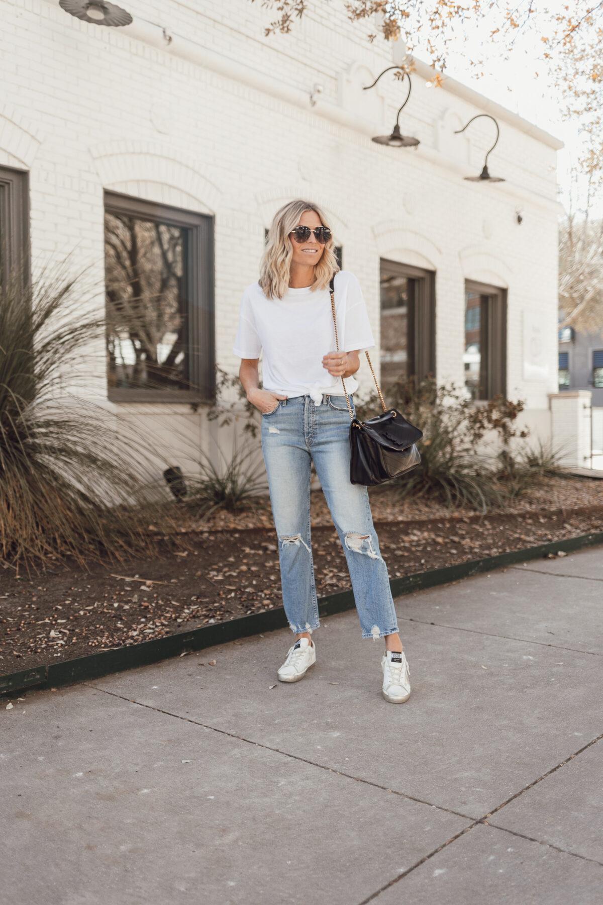 woman wearing white shirt and denim pants