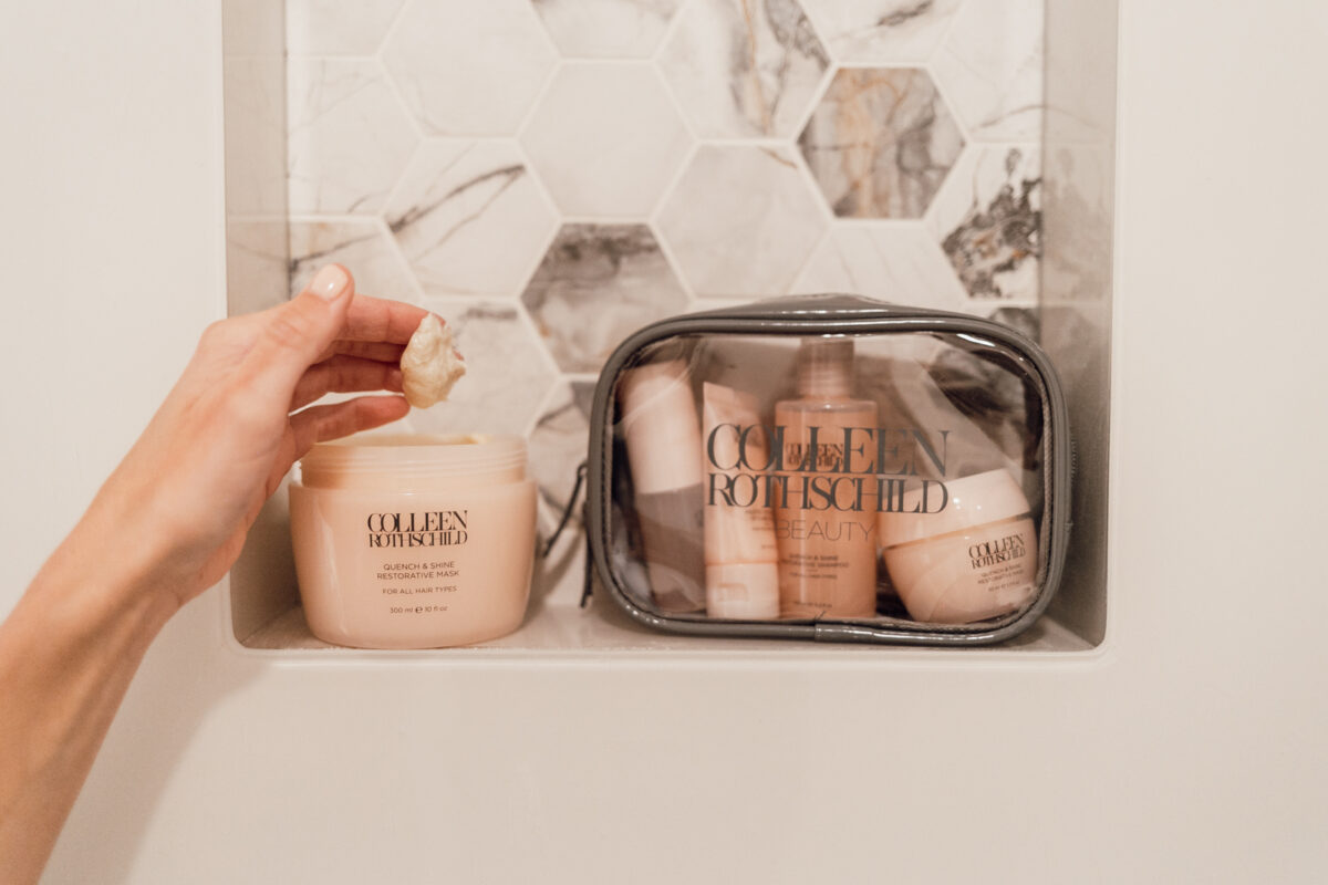 COLLEEN ROTHSCHILD BEAUTY products in a clear pouch and a hand reaching for the restorative mask