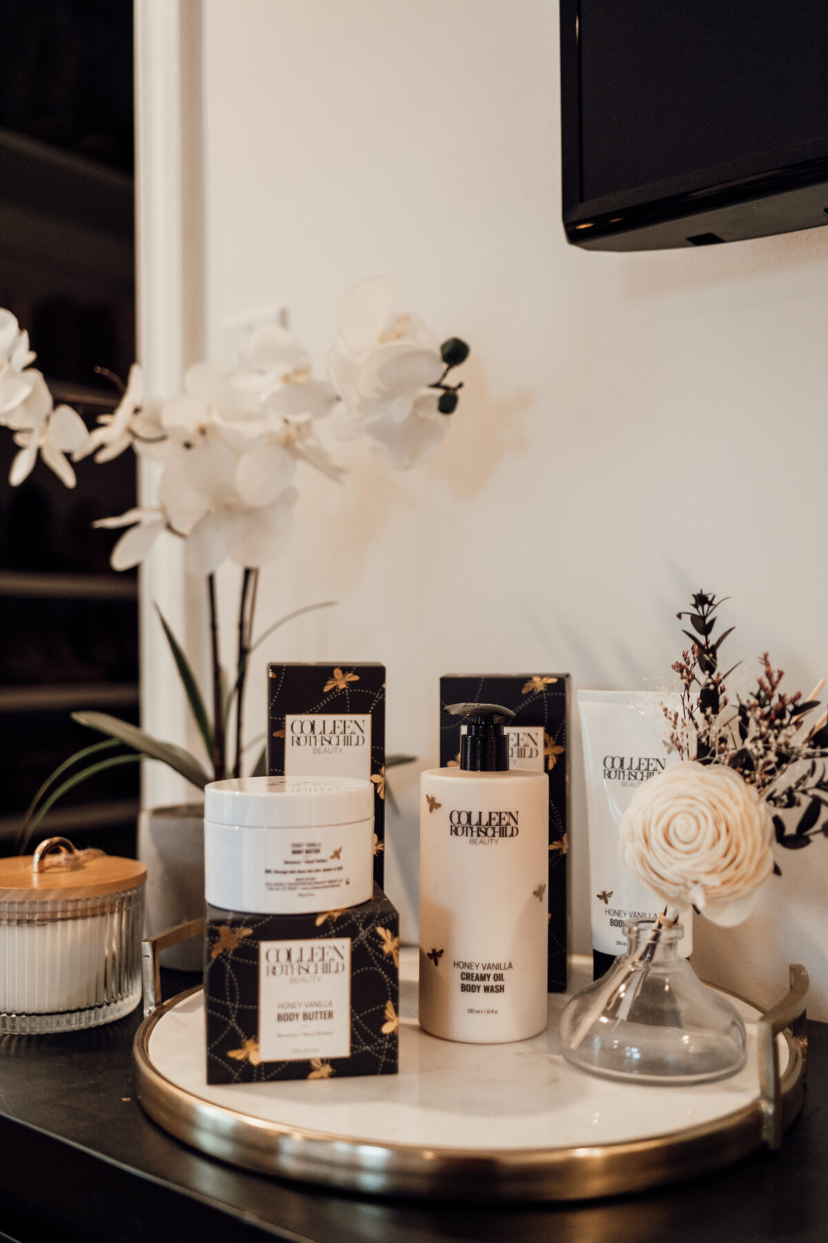 COLLEEN ROTHSCHILD BEAUTY products picture with flowers
