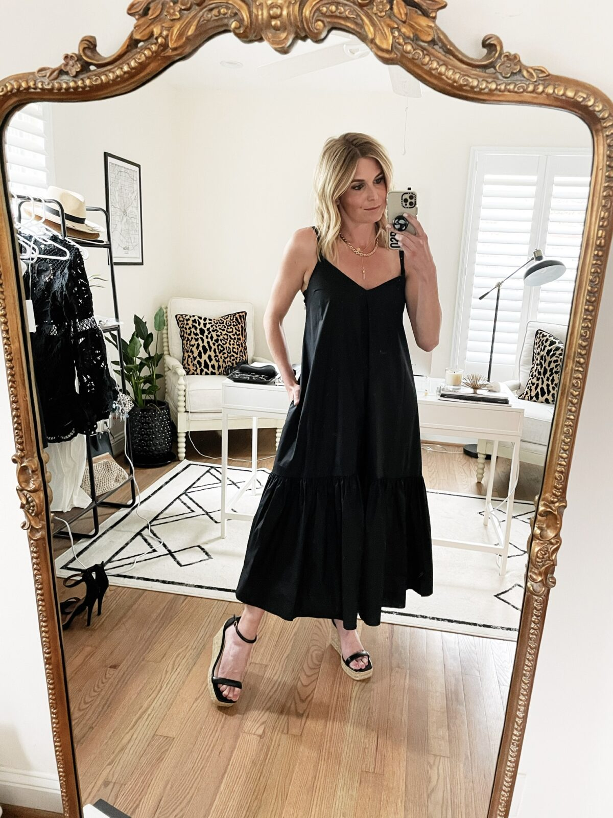 best of june woman taking a selfie and wearing a black dress