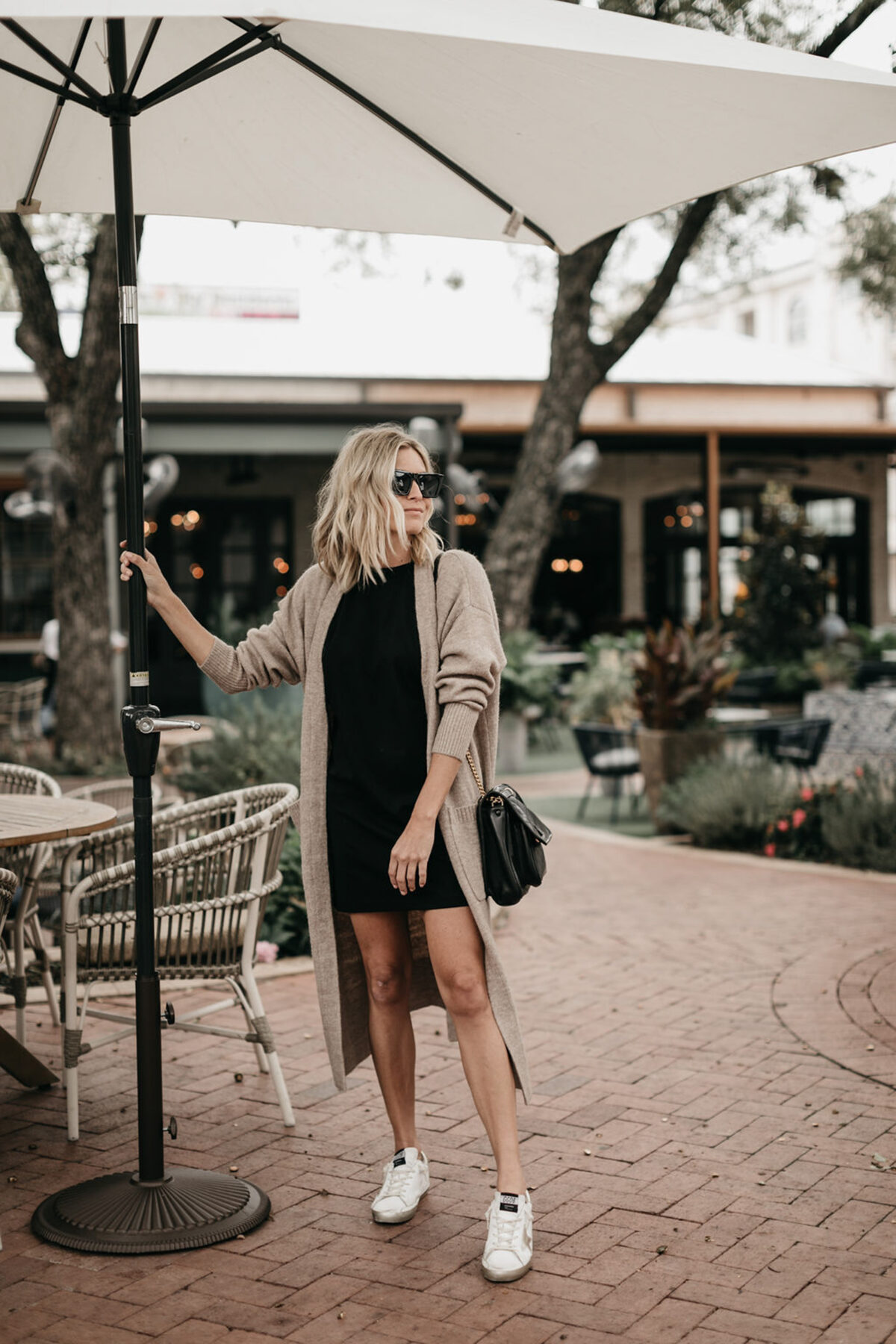 woman wearing black dress and cardigan for best of june