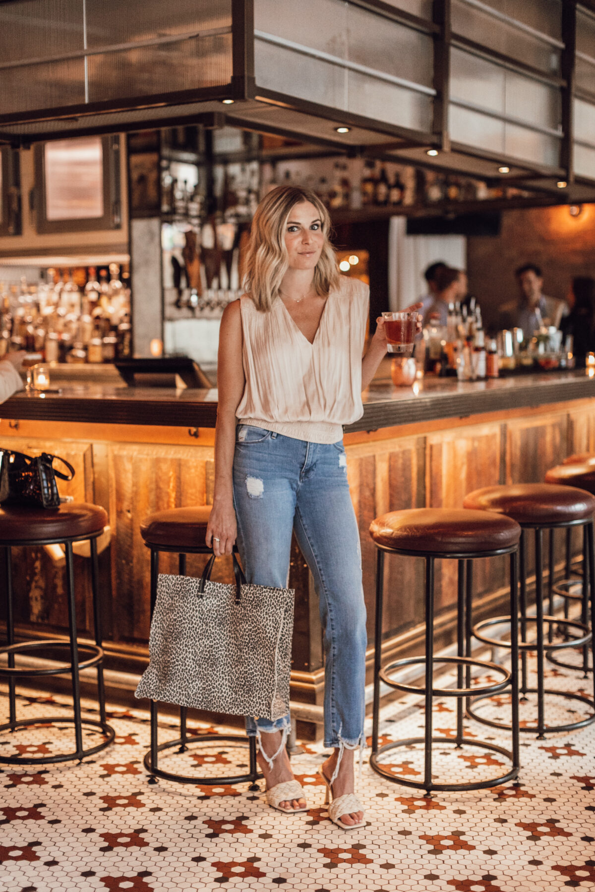 woman in a bar sharing BEST OF JULY 2021