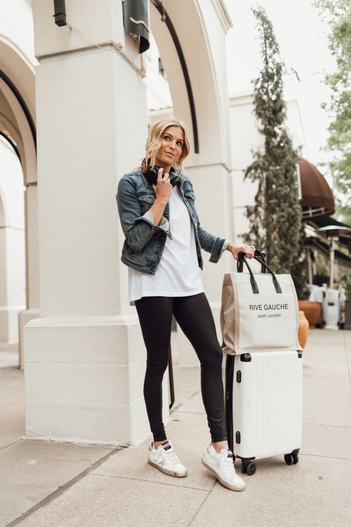 woman wearing leggings, shirt, and denim jacket for travel day guide