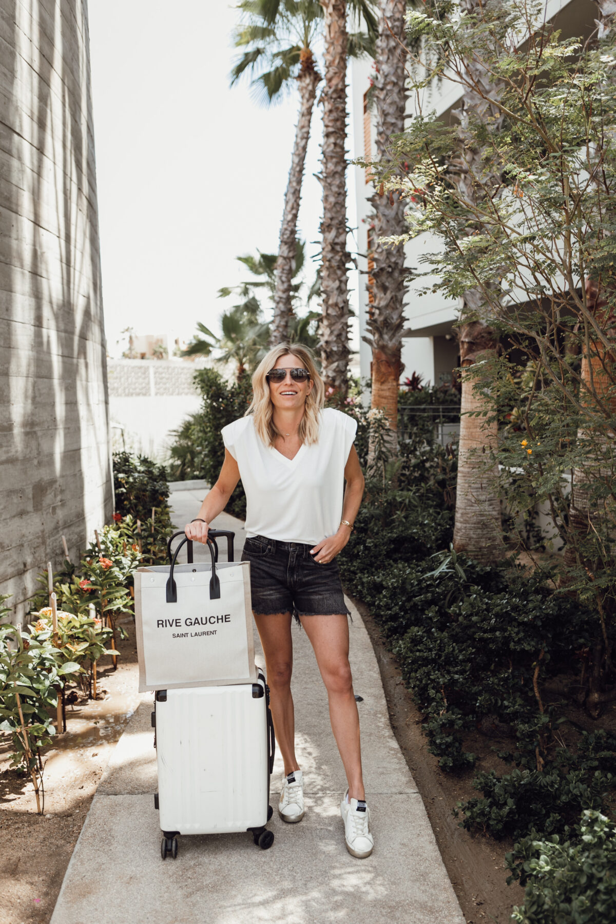 travel day guide woman wearing shorts and shirt
